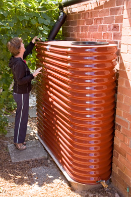 Domestic rainwater tanks come in a range of sizes, shapes and materials. This flatish, galvanised iron tank was installed at the home of Keelah Lam, from Manly Food Co-op.