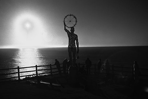 Seen from Cape Byron, the sun emerges from the Pacific. The sculpture was one of a number along the Cape Byron walking track during the annual sculpture festival.