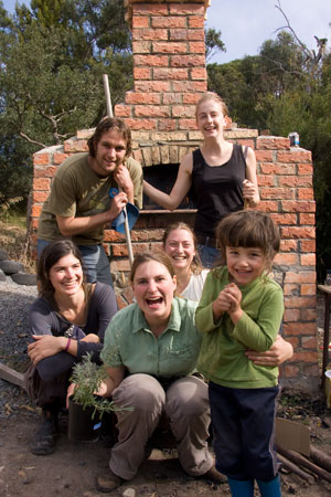 The crew and their new brickoven — The Source