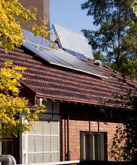 Solar electric and solar space hating arrays on the roof of Barrett house.
