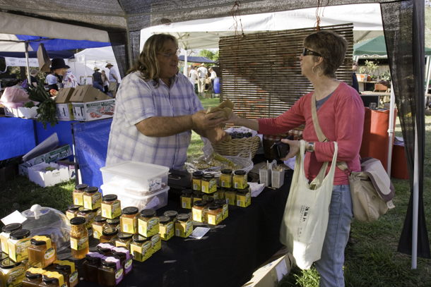 Farmers' markets are a small business part of the community food movement through which farmers direct sell to the people who will eat their produce. They improve financial returns to farmers by eliminating the middleman.