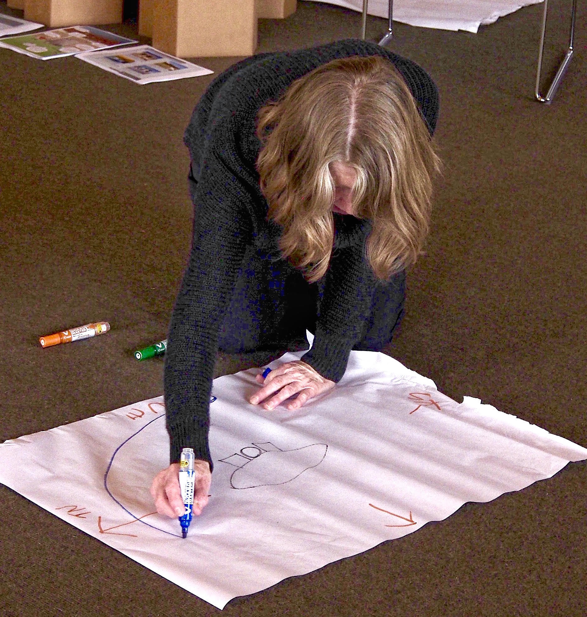 Fiona Campbell sketches a diagram while discussing site analysis.