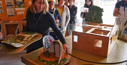 Fiona demonstrates landscaping for interior climate control using a model.